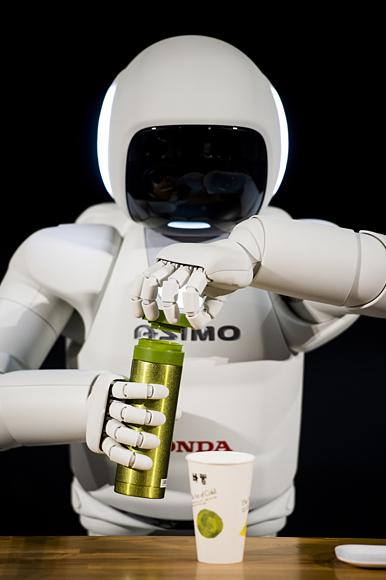 Asimo - Robot Manusia Dari Honda.